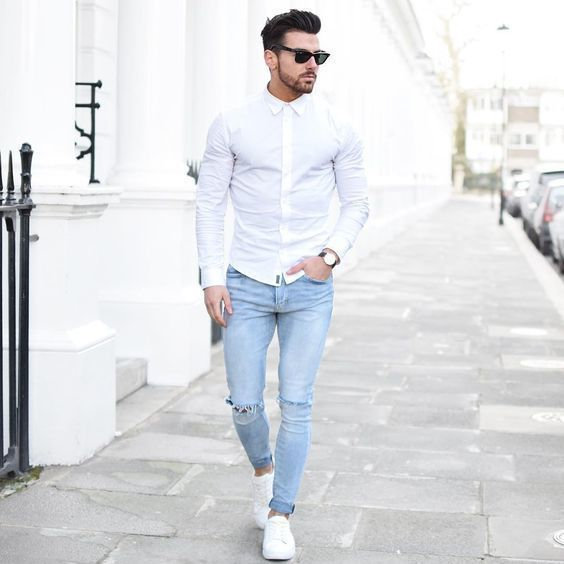 Stand Out Among Other Stylish Civilians In A White Oxford Shirt And Light Blue Ripped Skinny
