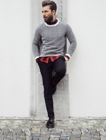 Dress In A Monochrome Chevron Crew Neck Sweater And Black Slim Jeans To Create