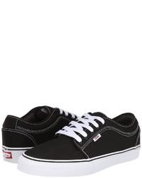 Baskets basses en toile noires et blanches Vans