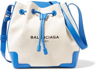 f311a5126 Balenciaga Leather Trimmed Canvas Bucket Bag Ecru, $1,095 | NET-A ...