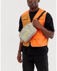 ASOS DESIGN Cross Body Bum Bag In Beige With Neon Yellow Text Print
