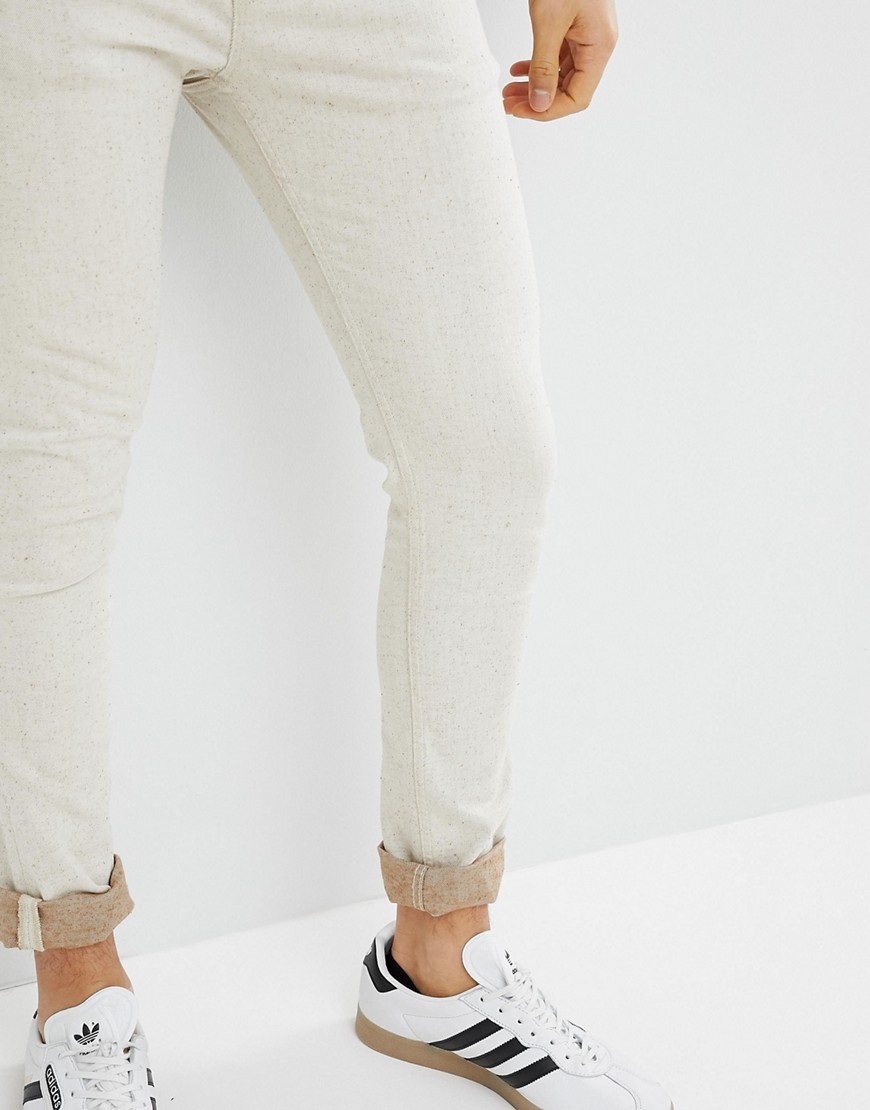 f527924f5 ASOS DESIGN Super Skinny Jeans In Ecru, $22 | Asos | Lookastic.com