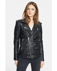 Pairing leather slim jeans with a motorcycle jacket is a comfortable option for running errands in the city.