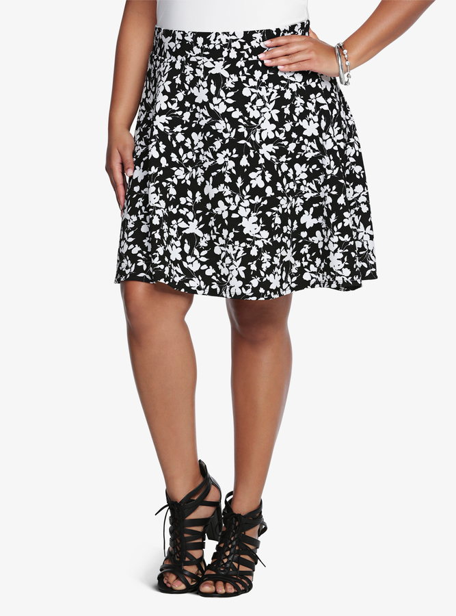 This woven skater skirt features an allover daisy print with a concealed side zipper. Find this Pin and more on Clothes&things wanted by gigi by Gigi Coulter. woman wearing white pullover hoodie, distressed denim jeans, and pair of brown slip-on shoes holding brown leather handbag.