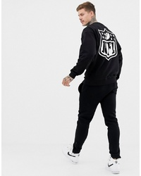 ASOS DESIGN Oversized Sweatshirt With Nfl Embroidery And Back Print In Black