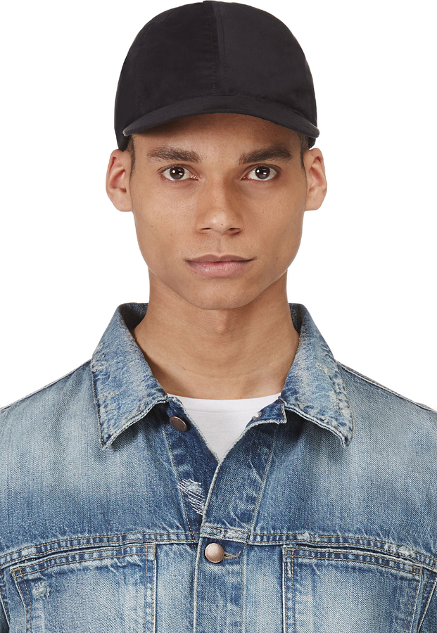 wearing baseball caps inside out black suede cap original indoors who started backwards