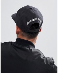 ASOS DESIGN Snapback In Black Peached Texture With Burn Your Bridges Embroidery