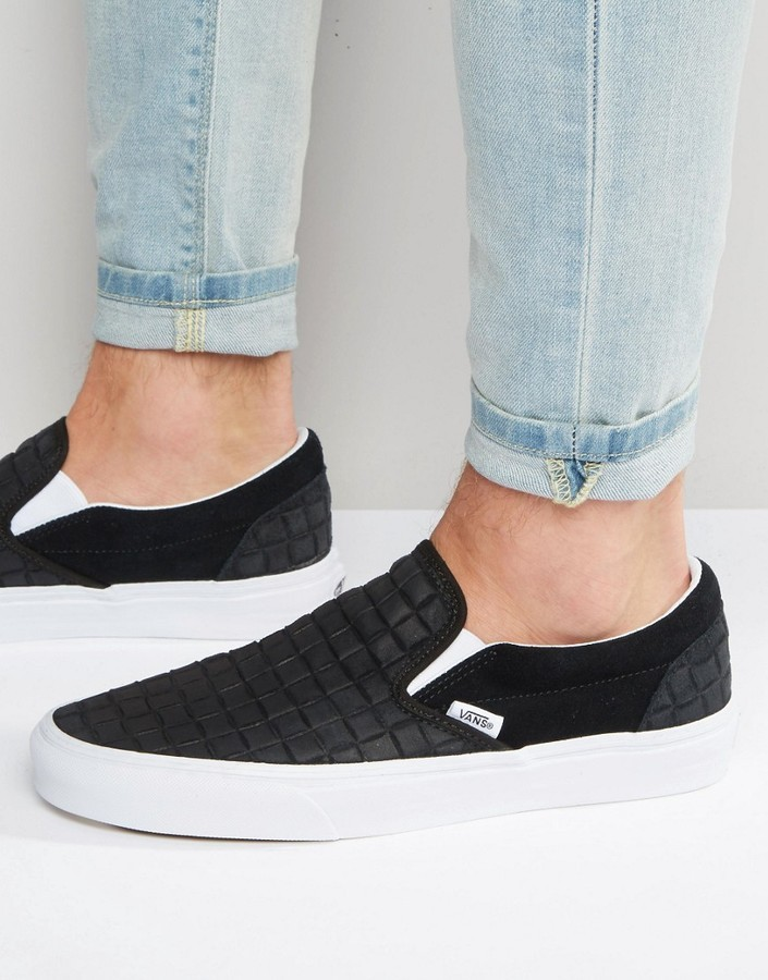 black on black checkerboard slip on vans