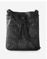 Express Perforated Tassel Cross Body Bag