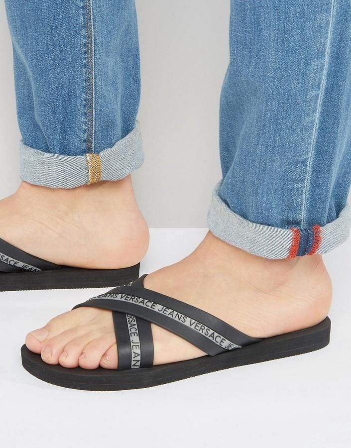 f2b8e048d ... Flops Versace Jeans Logo Crossover Flip Flop In Black ...
