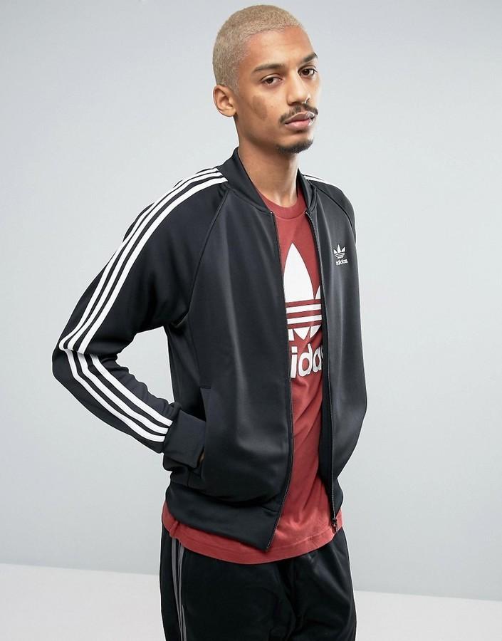 Schwarze adidas jacke kombinieren