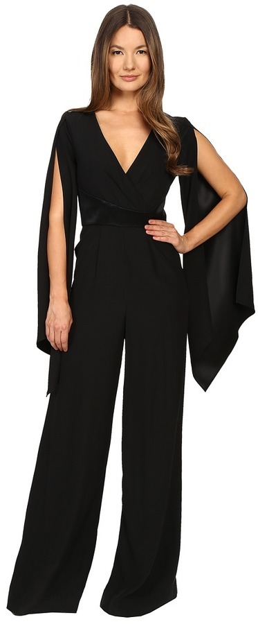 Gabriela Cadena Crepe Jumpsuit With Satin Waist And Cape Sleeve