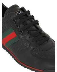 3bb0ce76fe5 ... Gucci Sl73 Gg Embossed Leather Sneakers ...