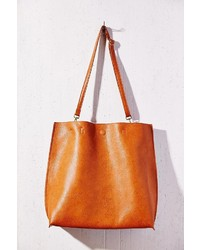 11a7eb3b6761e Urban Outfitters Oversized Reversible Vegan Leather Tote Bag, $79 ...