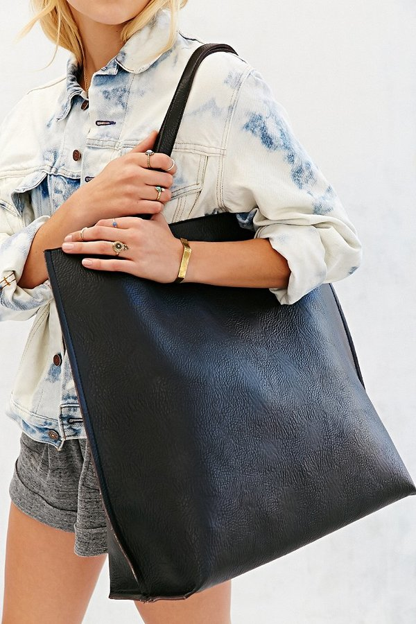 0dbfb111360 $79, Urban Outfitters Oversized Reversible Vegan Leather Tote Bag