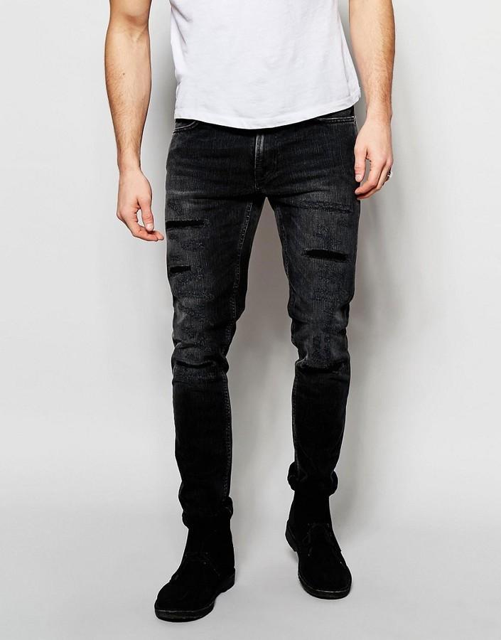 69d23315dd4 ... Nudie Jeans Lean Dean Slim Tapered Fit Deep Black Worn Distressed ...