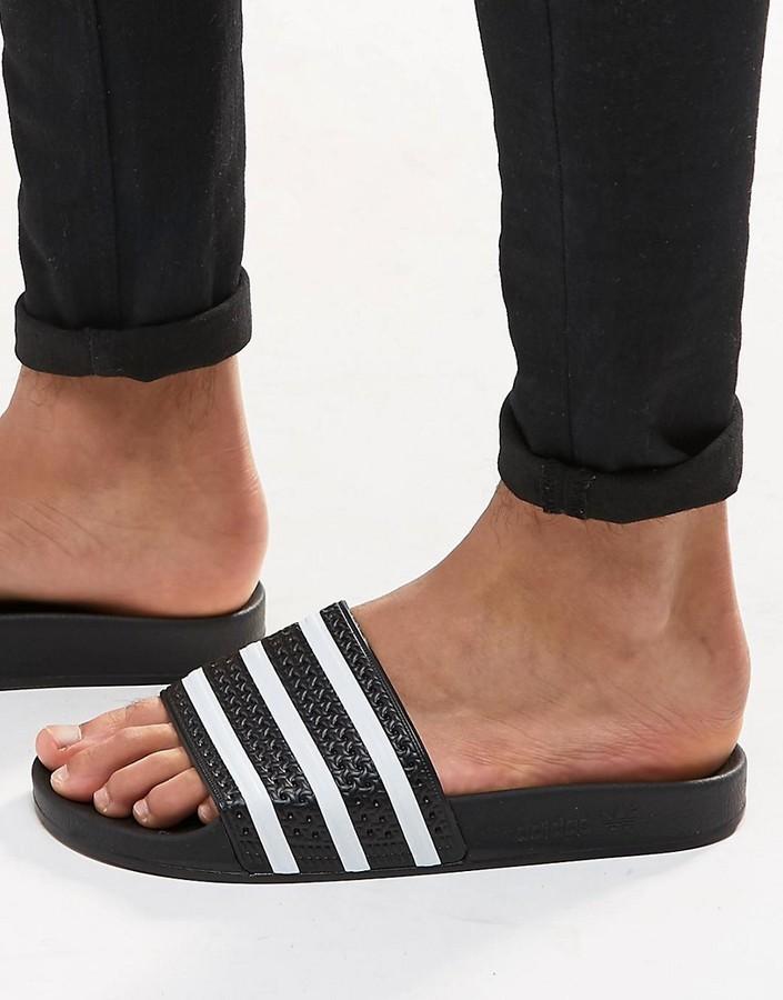 e7447ce1691b ... adidas Originals Adilette Sliders In Black 280647 ...