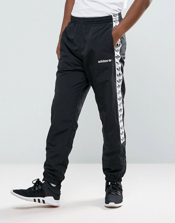 $85, adidas Originals Adicolor Tnt Tape Wind Track Joggers In Black Aj8830