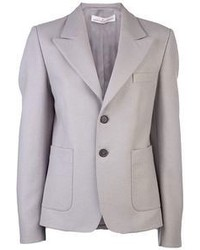 Pairing pastel green skinny jeans with a blazer is a comfortable option for running errands in the city.