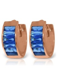 Galaxy Gold Products 14k Rose Gold Blue Zirconia Huggie Earrings