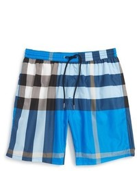 202bc037f8bd3 Men's Blue Plaid Swim Shorts by Burberry | Men's Fashion | Lookastic.com