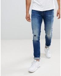 889ec15729 ASOS DESIGN Asos Skinny Jeans In Dark Wash Blue With Abrasions
