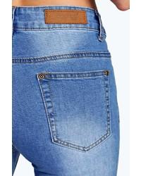 Boohoo Jess Mid Rise Busted Knee Super Skinny Jeans