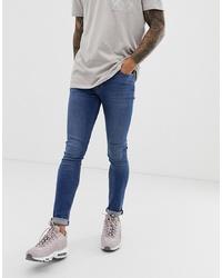 ASOS DESIGN Super Skinny Jeans In Mid Wash
