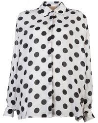 Blusa de botones a lunares en blanco y negro