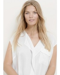Blusa de manga corta con volante blanca