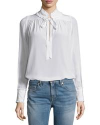 Blusa de manga larga con volante blanca de Roberto Cavalli