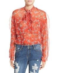 Blusa de seda con volante naranja de The Kooples
