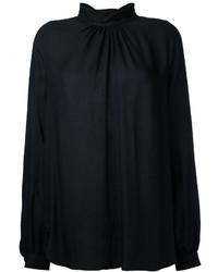 Blusa negra de Muveil