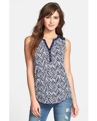 Blusa sin mangas estampada en azul marino y blanco