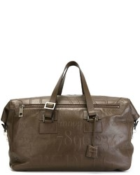 Bolsa de viaje de cuero marrón de Assouline