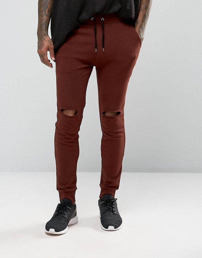 ... Asos Super Skinny Joggers With Knee Rips In Dark Red ...