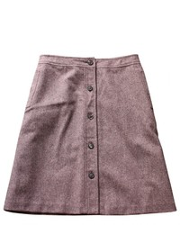 Marry burgundy suede ankle boots with a button skirt for a comfortable outfit that's also put together nicely.