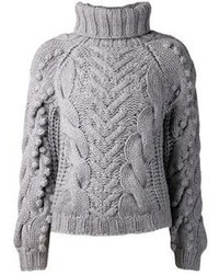 Pair a jacket with a cable knit sweater for an easy to wear look.