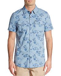 Camisa de manga corta con print de flores celeste