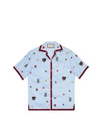 Camisa de manga corta con print de flores celeste de Gucci
