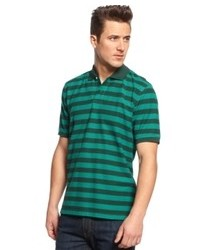 Camisa polo de rayas horizontales en azul marino y verde