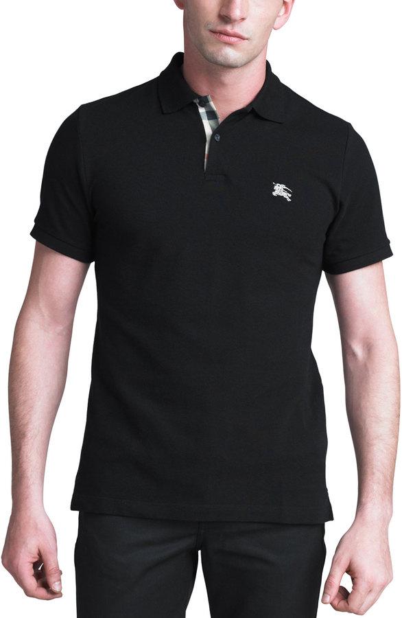 a0922366 $175, Camisa polo negra de Burberry