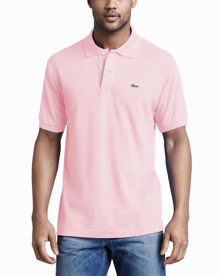57f24ba3990ed ... Camisa polo rosada de Lacoste ...