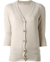 Pair a pale pink crew-neck pullover with a cardigan for an effortless kind of elegance.