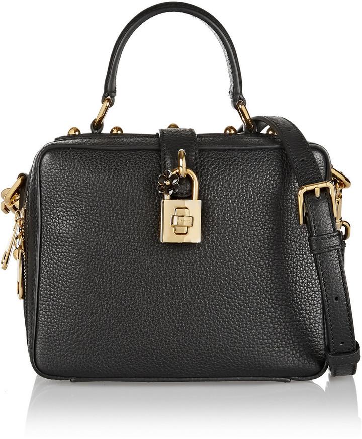 Cartera de cuero negra de Dolce   Gabbana  dónde comprar y cómo combinar 16357e03ce