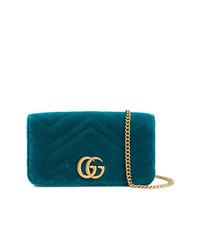 Cartera sobre de ante en verde azulado de Gucci