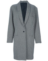 This combination of a navy blue fitted dress and a coat oozes refined elegance.