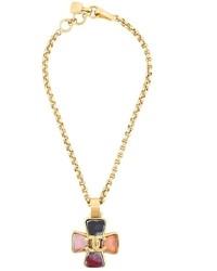 Colgante dorado de Chanel