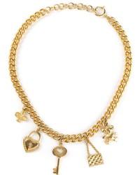 Collar dorado de Moschino