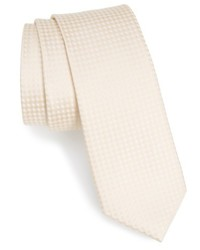 Corbata a cuadros en beige